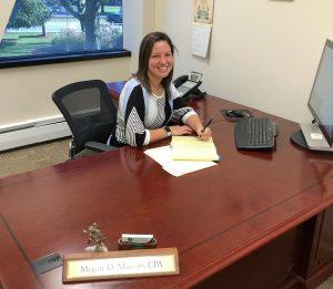 Megan Muccio sitting at her desk at work