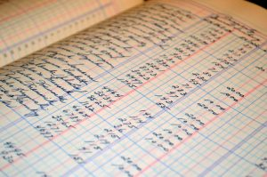 Ledger paper with lines of names and dollar amounts