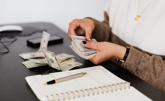 Organizing money while tracking expenses for budgeting review