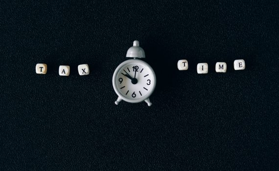 Clock with Tax Time Writing