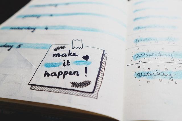 Calendar with Make it Happen! Written on it